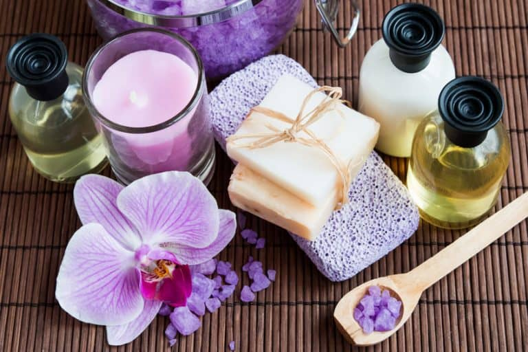 Spa composition with salt, soap, bottles and pink orchid