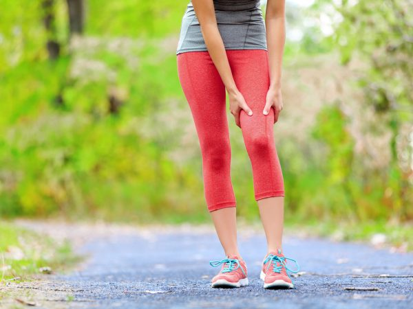 35218029 – sports muscle injury of female runner thigh. woman running muscle strain injury in thigh. closeup of runner touching leg in muscle pain.