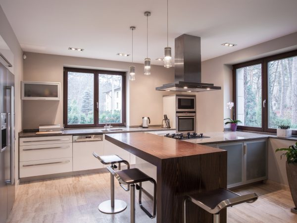 Horizontal view of spacious modern kitchen interior