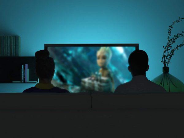 Personas viendo tele