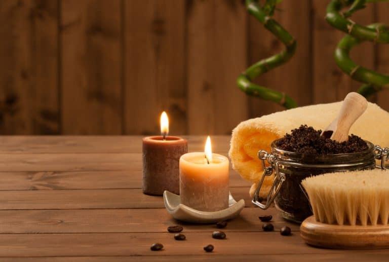 Handmade Coffee Scrub With Argan Oil. Burning Candles. Decorative Bamboo Shoots. Spa Room