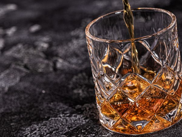Whiskey on a stone dark background.