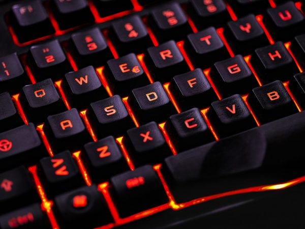 Detail of the keys of a backlit qwerty keyboard for gaming computers