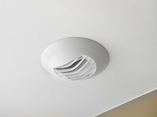 Wall electric extractor fan in the kitchen