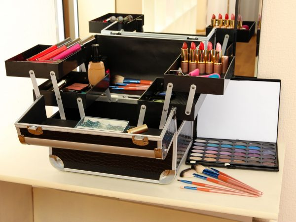 20504494 – open case with cosmetics on table near mirror