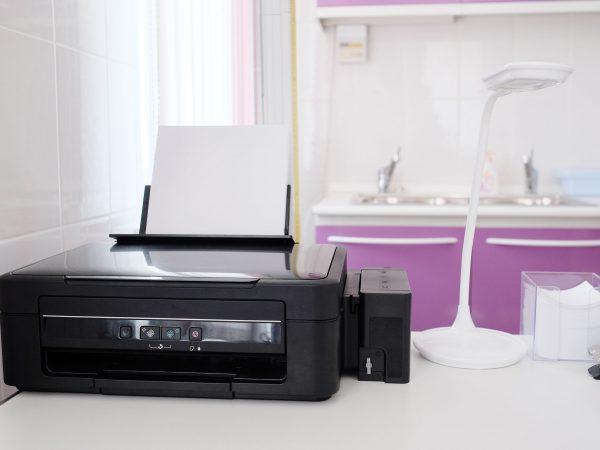 Black printer and paper closeup