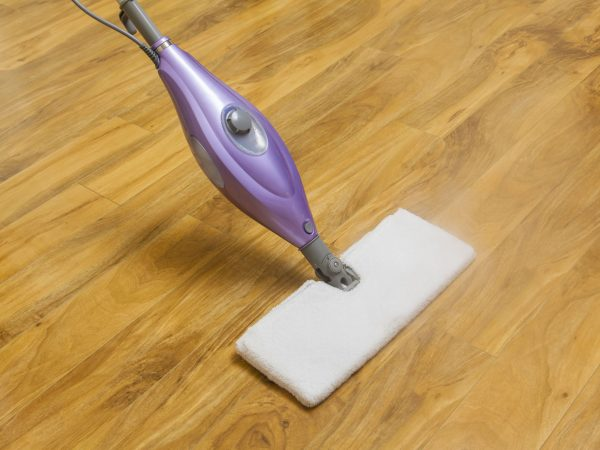 Using a steam mop to clean wooden floor