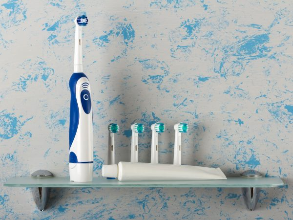 Electronic toothbrush and nozzles, paste on the shelf
