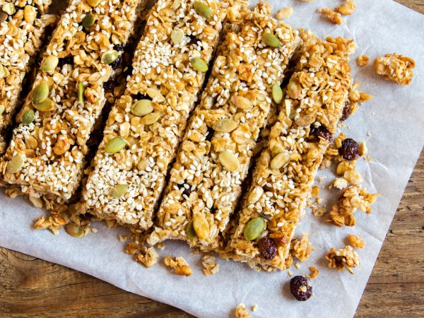 Organic homemade granola bars on rustic wooden background – Healthy vegetarian snack
