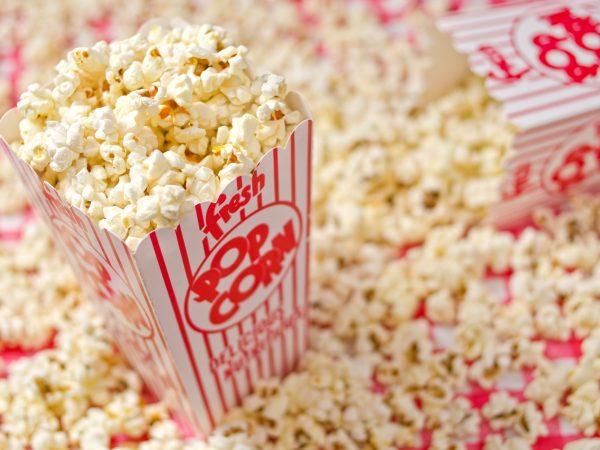 18935814 – freshly popped popcorn against a popcorn background.