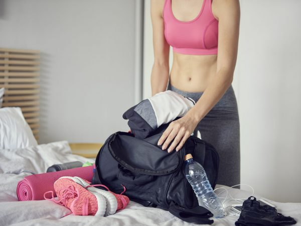 Woman packing bag for the gym