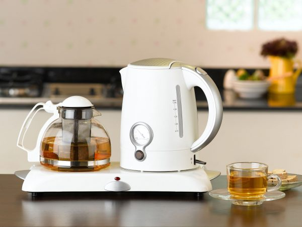 16930795 – electric kettle and glass pot for tea time or coffee time