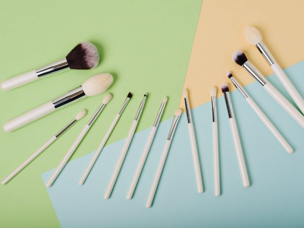 Makeup brushes on a multicolored background close up