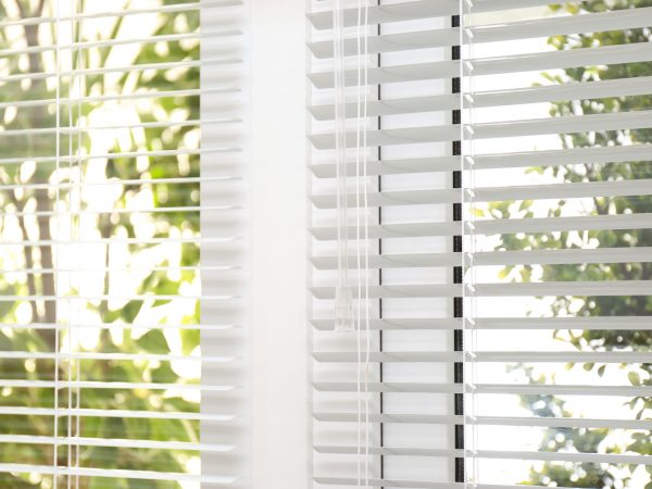 Open white horizontal window blinds, closeup view