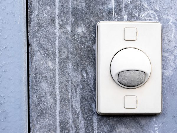 Doorbell ring button on the wall