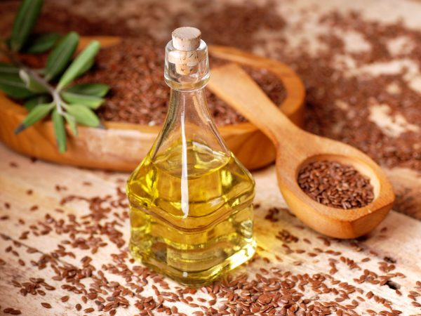 essential oil of linseed in the small glass bottle