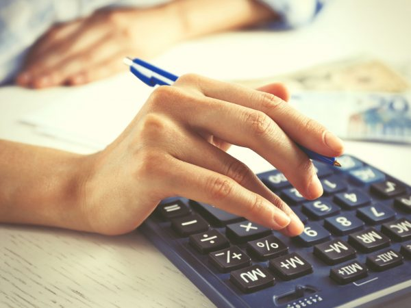 47947427 – accounting concept.analyzing finance report with calculator