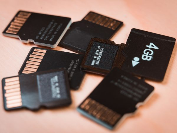 Group of MicroSD cards over a wooden table. Macro shot