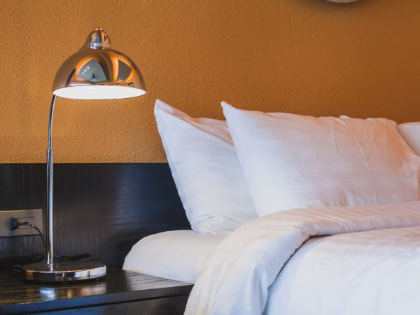 hotel room abstract interior, lamp near the bed