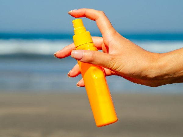 sunscreen on the background of the beach in Asia.