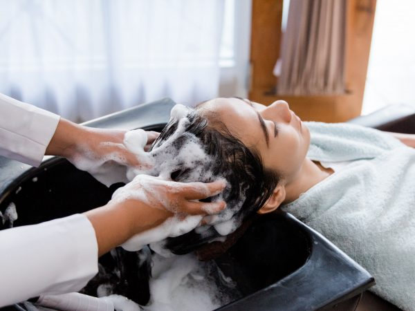 hair washed in beauty salon. happy young woman hair treatment
