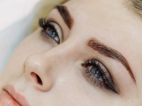 Result of permanent makeup, tattooing of eyebrows in beauty salon