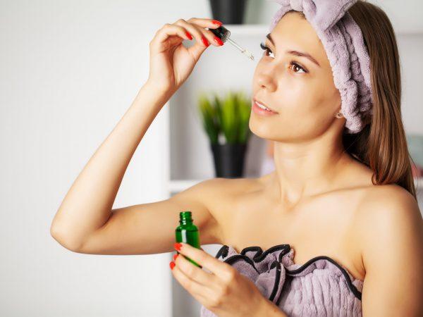 Women skin care, cosmetic oil vitamins to restore facial skin.