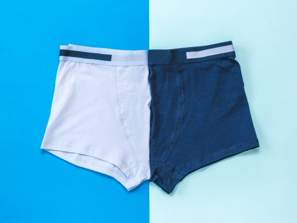 Two men's underpants on a two-color background. Men's underwear.