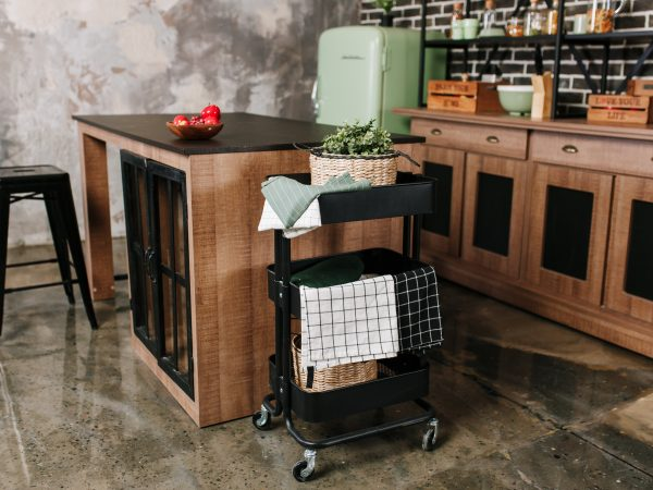 Cozy loft kitchen with dinning table, chairs and metal storage racks on wheels – trolley.