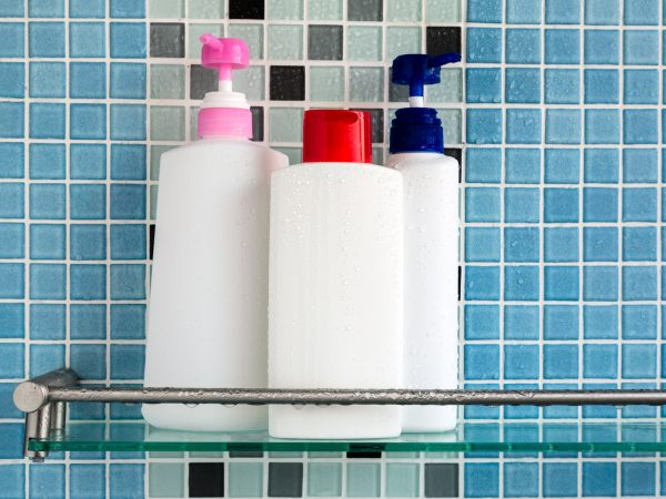 Group of shampoo bottles in a bathroom