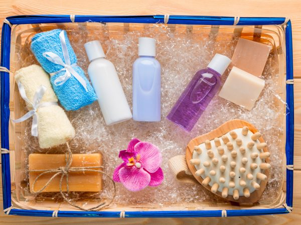 hygiene products and accessories in a straw basket top view