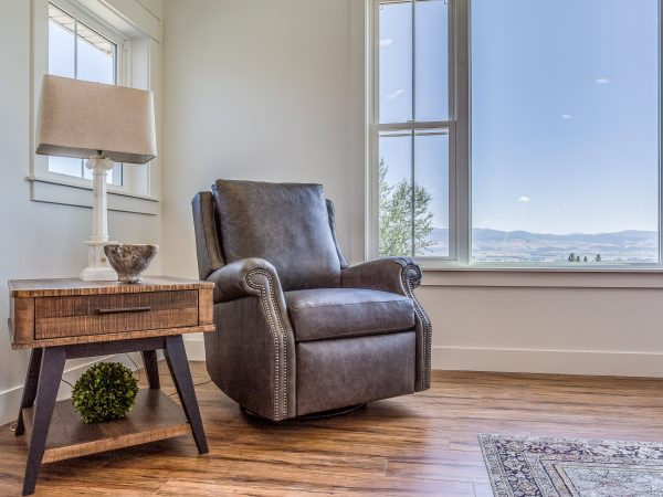 Leather chair for reading in corner of master bedroom