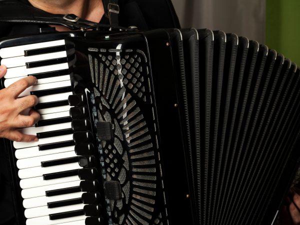 man play the accordion, close up