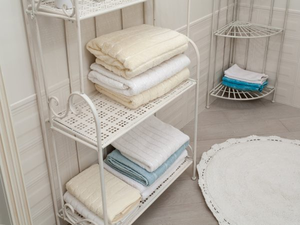 light coloured bathroom towels on the iron-shod vintage shelves