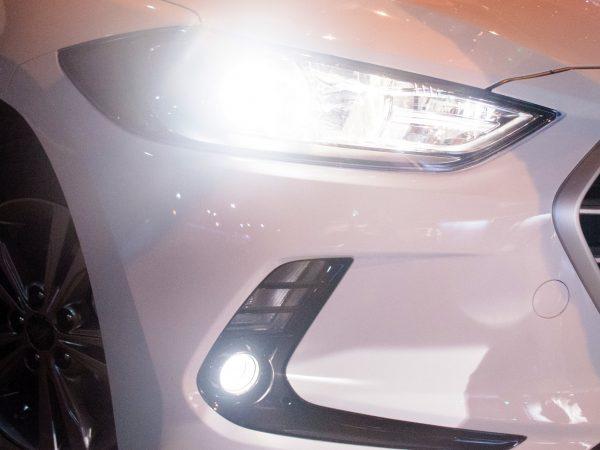 Luminous car headlight at night