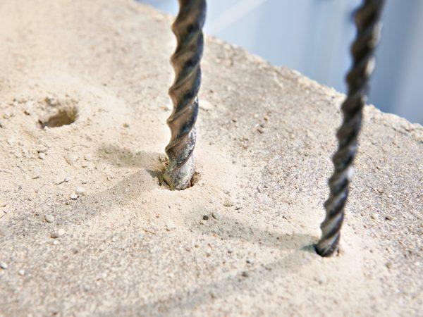 Drill bit for drilling of concrete
